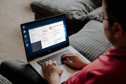 Man using 1Password app on the couch